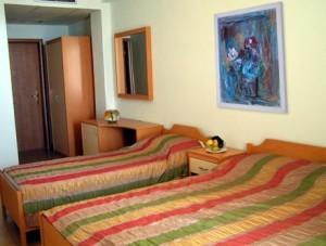 Dreibettzimmer im Hotel Oaz